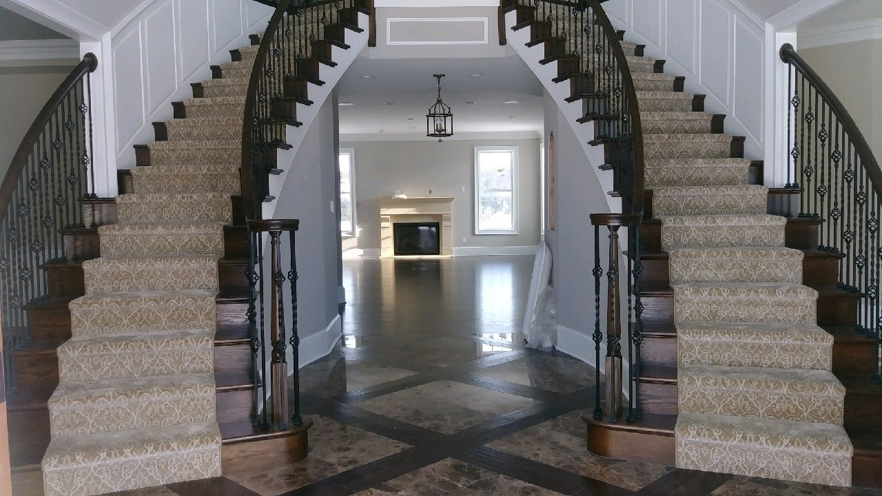 double staircase with custom rug